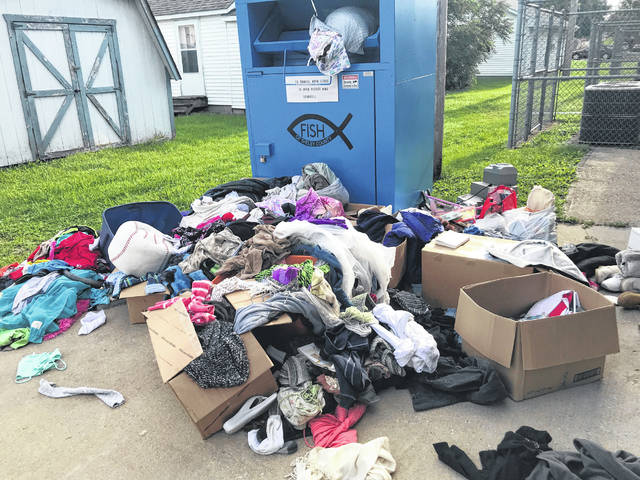 Donations left outside of the blue donation bin at FISH of Shelby County have been destroyed by rain and people who rummage through the items. FISH requested that donors bring donations into the store or leave them in the donation bin, not outside the bin.