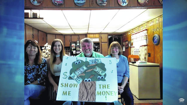 """Sidney resident John Cole, third from left, won $20,600 on Saturday's episode of the Ohio Lottery game show """"Cash Explosion."""" Also pictured, left to right, is his sister, Susan Fogt, niece, Alexis Younker, and mom, Anna Cole."""
