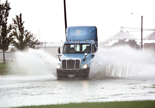 A flooded section of road at 320 S Stolle Ave., proved not obstacle to a semi cab after heavy rain caused minor street flooding on Monday, August 3.