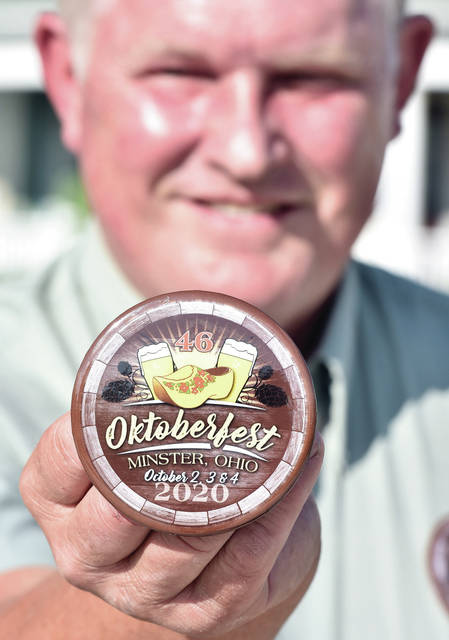 Button House Chair, Leon Mertz, of Minster, displays the 2020 Minster Oktoberfest button during an unveiling in Minster on Tuesday, August 18. The button was designed by Sherri Thobe, of Osgood.