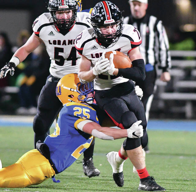 Fort Loramie sophomore running back Damon Mescher is tackled by Marion Local's Brandon Fleck during a Division VII, Region 28 semifinal on Nov. 16, 2019 at Alumni Field in St. Marys. Mescher suffered a shoulder injury in Week 1 and will miss the rest of the season.