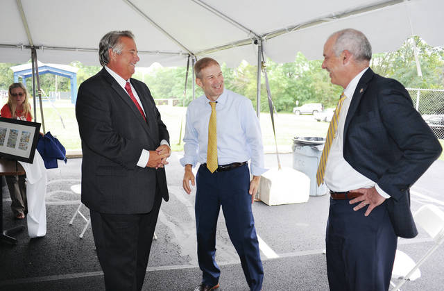 Ferguson Construction Co. CEO Mick Given, left to right, talks with U.S. Rep. Jim Jordan and Ohio state Sen. Matt Huffman during a celebration marking the 100th anniversary of Ferguson Construction on Thursday, Sept. 10. In the background, left of Given, can be seen the shelter Ferguson Construction Co. donated to the city of Sidney during the celebration.