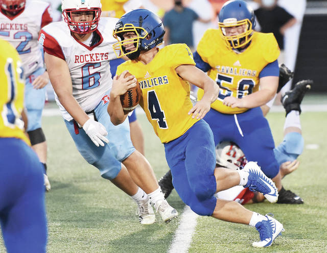Lehman Catholic's Nathan Sollmann runs during a Northwest Central Conference game against Ridgedale on Sept. 12 at Sidney Memorial Stadium. The Cavaliers' NWCC game scheduled for this Friday at Waynesfield-Goshen has been postponed.