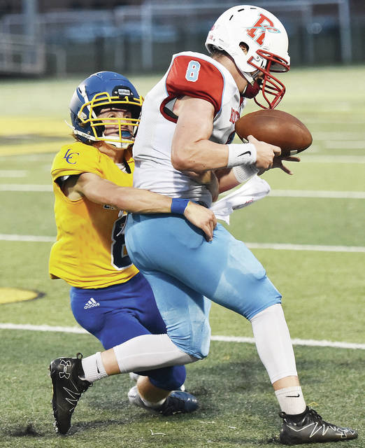 Lehman Catholic's Hayden Sever tackles Ridgedale's Kraven Sayre during a Northwest Central Conference game on Saturday at Sidney Memorial Stadium.