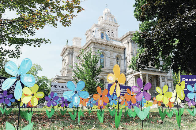 A promise garden was set-up on the courtsquare from noon to 3 p.m. to promote the Walk to End Alzheimers on Saturday, Sept. 12.