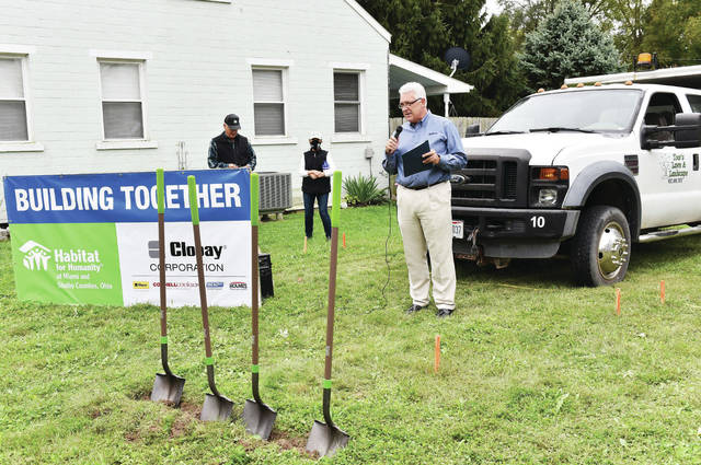 Clopay Corporation President Steve Lynch speaks during the groundbreaking ceremony for a new Habitat for Humanity house at 737 Broadway Ave., on Tuesday, Sept. 29. The house is being built for Clopay Corporation employee Marie Strunk and her family.
