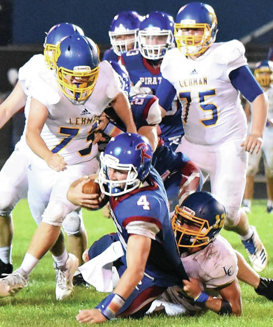 Riverside's Kale Long fights for extra yardage while being brought down by Lehman Catholic defenders during a Northwest Central Conference game on Sept. 21, 2019 at Veterans Memorial Field in De Graff. The squads will face off in an NWCC game on Friday at Sidney Memorial Stadium.