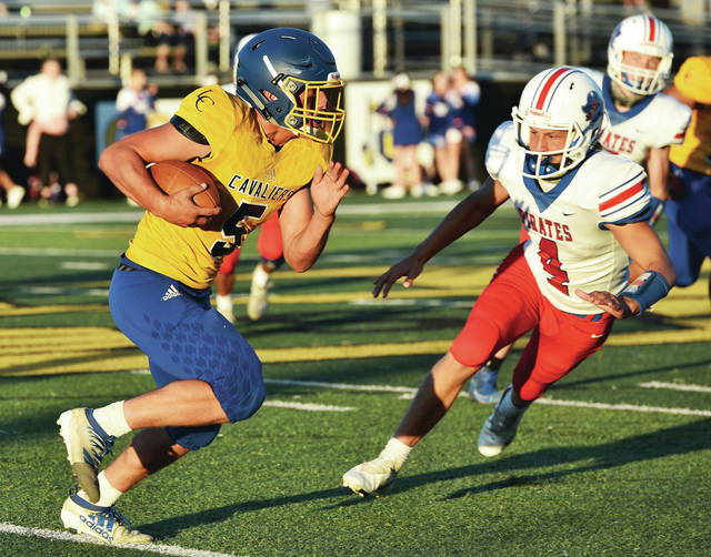 Lehman Catholic's John Edwards runs as Riverside's Myles Platfoot pursues during a Northwest Central Conference game on Friday at Sidney Memorial Stadium.