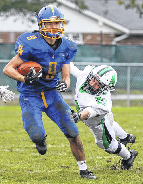 Anna's Isaac Egbert tries to tackle Delphos St. John's Devin Linderman during a Midwest Athletic Conference game on Oct. 27, 2018 in Delphos. Egbert made 26 tackles in Anna's first two games.