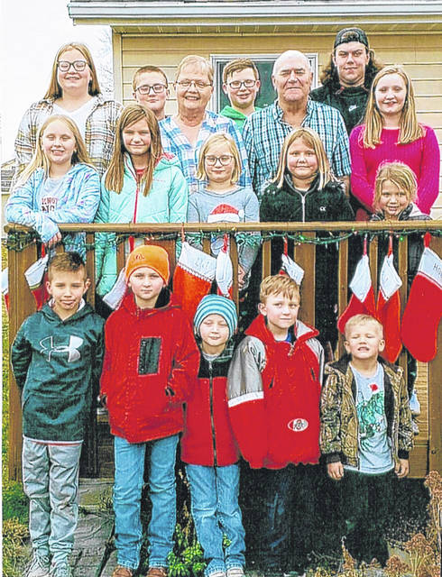 Mr. and Mrs. Ellinger, pictured with their 15 grandchildren, front row, left to right: Luke Ellinger, Nickolas Dwenger, Joseph Dwenger, Henry Dwenger, William Ellinger; second row, left to right: Samantha Dwenger, Ella Ellinger, Madeline Gehret, Molly Ellinger, Leah Ellinger; third row, left to right: Josephine Gehret, Donna and Don Ellinger, Caroline Gehret; fourth row, left to right: Ben Gehret, Anthony Gehret and Dylan Steinke-Ellinger.
