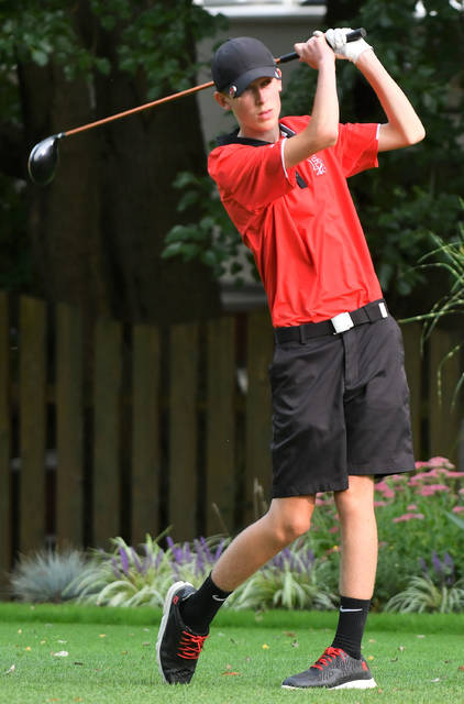Fort Loramie junior Ethan Larger watches his shot during a nonconference match against Milton-Union on Monday at Homestead Golf Course in Tipp City.