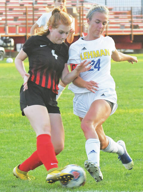 Lehman Catholic senior Noelle Dexter fights with a Milton-Union player for the ball during a nonconference game on Tuesday in West Milton. Dexter, who attends church in West Milton and knows several Milton-Union players, scored the game-winning goal with 10 minutes left.