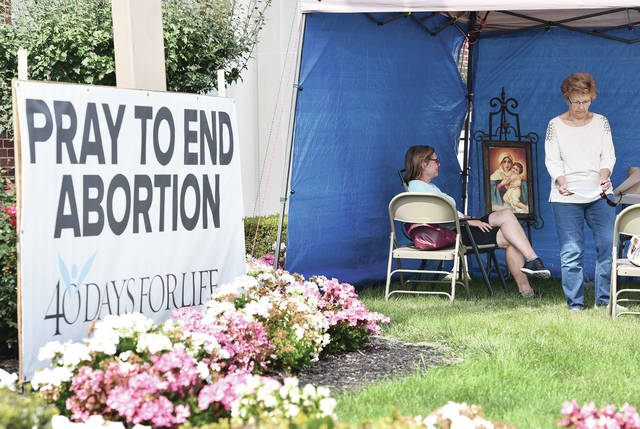 Barbara Krebs, left, and Linda Christman, both of Botkins, pray to end abortion during a 40 hour vigil at Immaculate Conception in Botkins on Wednesday, Sept. 23. The vigil is part of the international 40 Days of Life Campaign.