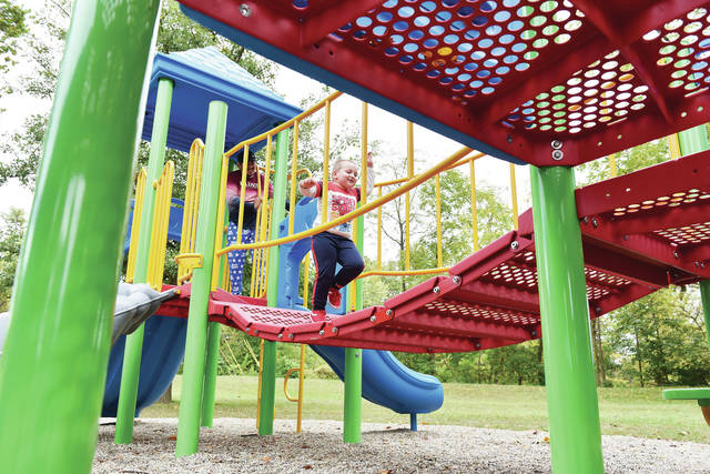 Jaxxyn Pierce, right, 4, runs from Masin Richey, while playing on the new jungle gym at Roadside Park on Tuesday, Sept. 29. Jaxxyn's mom, Chay Murphy, said they hadn't seen the new jungle gym yet and wanted to check it out after picking Jaxxyn up from school. Shortly after being built the jungle gym had been closed due to COVID-19.