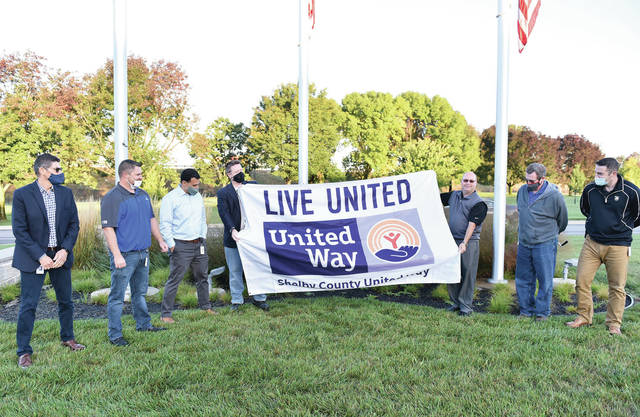 Emerson employees and Shelby County United Way President/CEO Scott Barr prepare to raise the United Way flag at Emerson Tuesday, Sept. 29. On hand for the ceremony were, left to right, Vice President Operational Excellence Rene Betance; Program Manager and United Way Committee Chairperson John Thompson, Senior Product Planner Brad Hemmick; Senior Test Equipment/Calibration Engineer Shawn Bolte; Barr; Product Planner Doug Ealy; and Market Manager Stephen Hueckel.