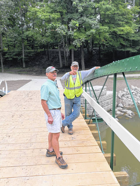 Ohio Historic Bridge Association President David Simmons, left, listens as retired Auglaize County bridge engineer Dan Bennett explains one of the problems encountered with relocating the Zenas King bridge from rural Shelby County to Tawawa Park when he visited Sidney recently.