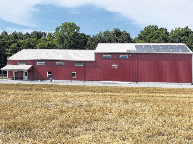 A barn on the Hopyard 29 farm, east of Sidney near Pasco, is pictured with solar panels on its roof which helps to create power used to process and preserve hops sold to microbreweries and distilleries throughout the Midwest.