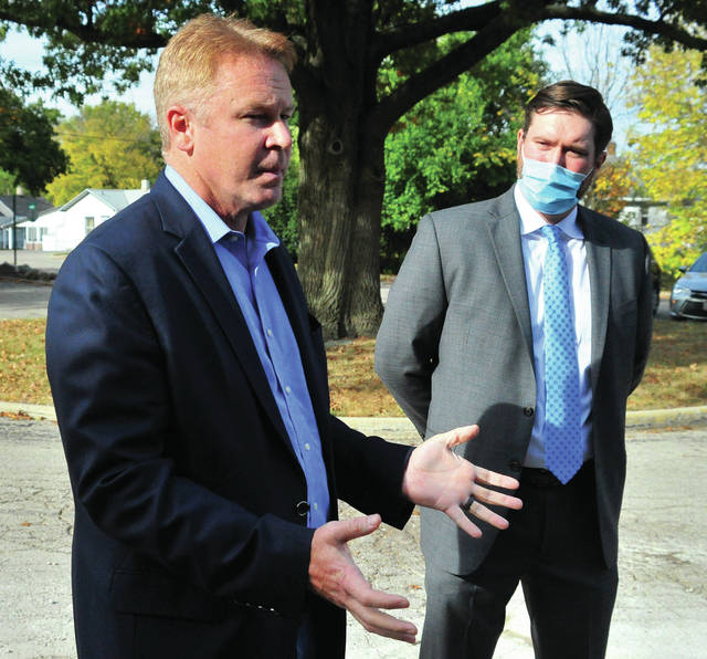 Rep. Warren Davidson, left, and J.R. Turner, general manager for Novacel in Troy, discuss the new line of disposable masks going into production at the Union Street facility, following a plant tour on Wednesday.