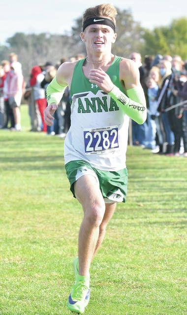 """Anna's Hayden Schmidt runs during the Division III district meet boys Race """"B"""" on Saturday at Cedarville University. Schmidt won an individual district title by finishing first."""