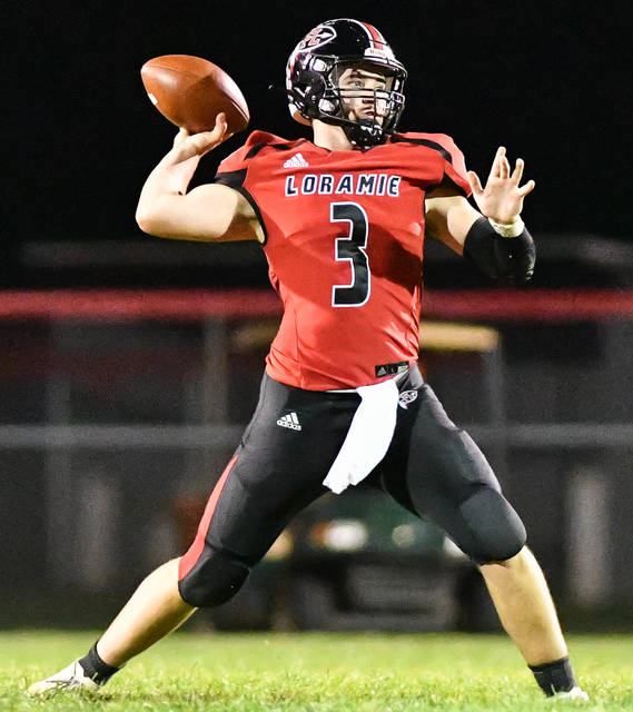 Fort Loramie senior quarterback Collin Moore throws during the first half of a Cross County Conference game on Sept. 17 at Smith Field in Covington. The Redskins are scheduled to host New Bremen in a Division VII regional semifinal on Friday.