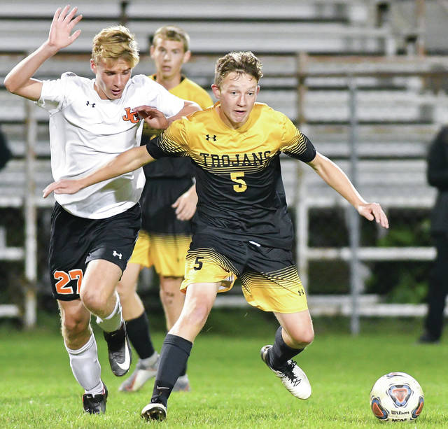 Botkins' Zack Ware, right, and Jackson Center's Ethan Pohlschneider chase after the ball during the first half of a Division III district semifinal on Oct. 22, 2019 at Wertz Stadium in Piqua. Ware and fellow senior Zane Paul have each scored 22 goals this season for the Trojans, which are the No. 2 ranked team in the Dayton Division III sectional.