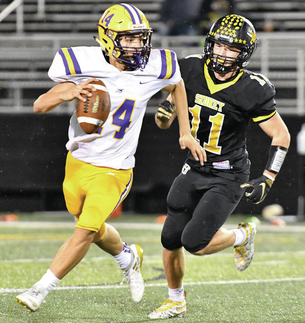 Sidney senior linebacker Beau Davis runs after Vandalia-Butler's Cody Joynes during a Miami Valley League game on Friday at Sidney Memorial Stadium. Davis made seven tackles in the 14-8 victory. The Yellow Jackets are scheduled to host Troy this Friday.