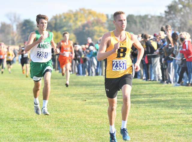 Botkins senior Alan Fullenkamp, front, and Anna senior Jacob Robinson will compete at the Division III regional meet Saturday.