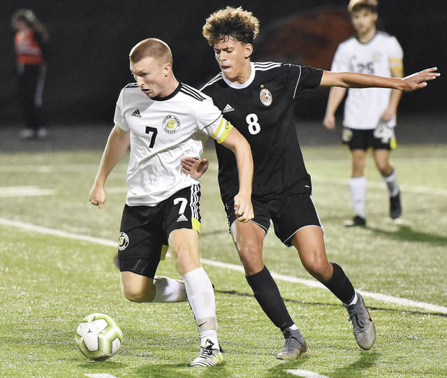 Sidney's Braden Guinther dribbles with pressure from Beavercreek's Pierson Davis during a Division I sectional final on Thursday at Frank Zink Field in Beavercreek. Guinther led the Yellow Jackets with 16 goals this season and ranked seventh in the Miami Valley League.
