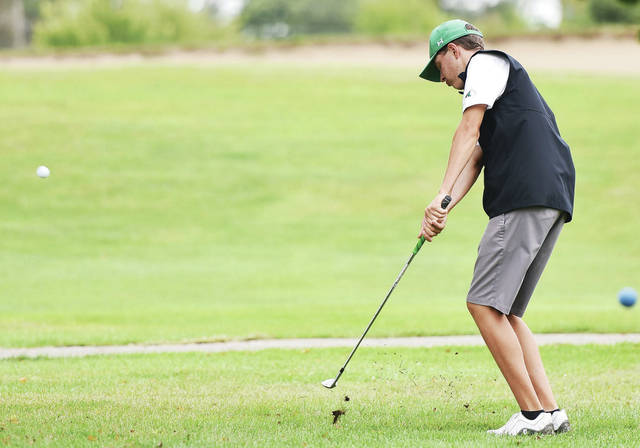Anna's Bryce Cobb swings during the SCAL boys golf tournament on Sept. 17 at the Shelby Oaks Golf Club in Sidney. Cobb finished first in the Division III sectional tournament on Tuesday at Shelby Oaks.