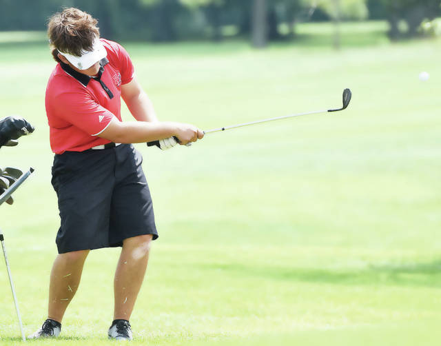 Fort Loramie's Devin Ratermann swings during the Shelby County Athletic League boys golf preview on Aug. 10 at Shelby Oaks Golf Club. Ratermann and fellow senior Caeleb Meyer will be leading the Redskins to their third consecutive state appearance this weekend.