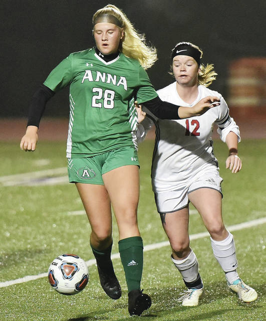 Anna's Carissa Edwards works the ball under pressure from Dixie's Kaylee Collins during a Division III district semifinal on Tuesday at Eaton High School.