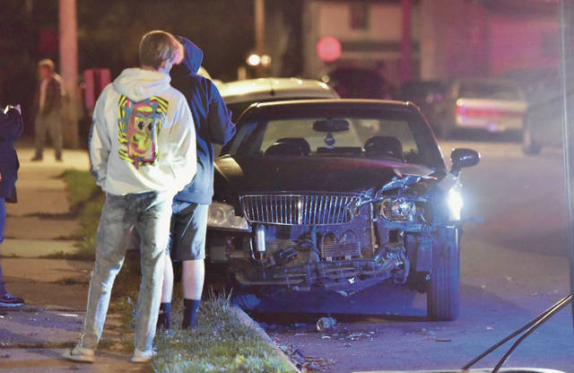 A parked car that was hit by the SUV.