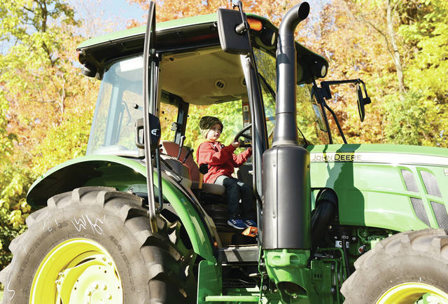 Ben Carter, 5, of Houston, son of Ryan and Nikki Carter, sits behind the wheel of a tractor during Fall Fun Day at Shelby Hills Preschool on Friday, Oct. 16. The annual event ran most of the day with a morning session and afternoon session. Kids could take a wagon ride, pet a kangaroo, grab a pumpkin, or ride a pony.
