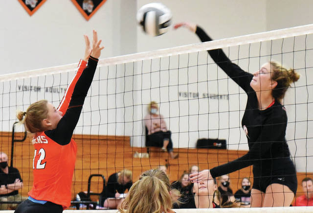 Fort Loramie's McKenzie Hoelscher spikes the ball as Jackson Center's Elena Platfoot tries to block during a Shelby County Athletic League match on Sept. 24 at Jackson Center. The Redskins, which advanced to the Division IV state final match last year, earned the top seed in the Troy sectional.