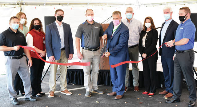 Participating in the ribbon cutting are (L – R) Dr. Malarkey, Sara Brehm, Rachel Yoder, Dr. McNeilan, Dr. Heckler, Mark Klosterman, Andy Counts, Julie Covault, Bill Gavigan, Dr. Reed.