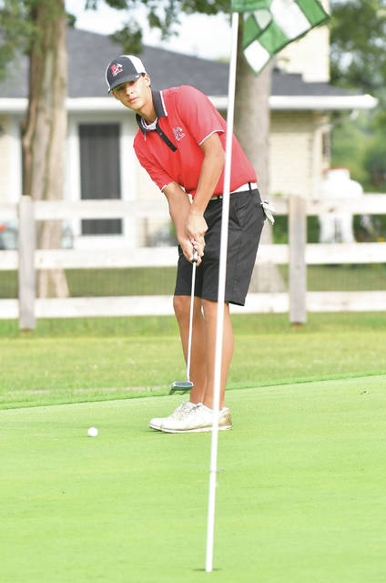 Fort Loramie sophomore Aiden Wehrman lines up his putt during a nonconference match against Milton-Union on Sept. 14 at Homestead Golf Course near Tipp City. Wehrman led the Redskins with a 79 during the Division III district tournament on Thursday in Beavercreek. Fort Loramie finished first and earned a state berth for the second consecutive year.