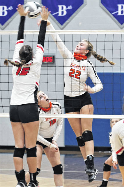 Versailles' Kaylee Braun spikes during a Division III sectional semifinal volleyball match against Greenon on Wednesday at Brookville High School.