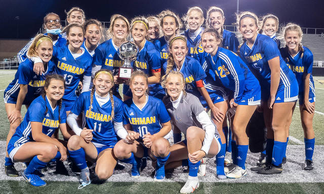 Lehman players pose wih the Western Ohio Soccer League trophy following a 1-0 win over Anna on Saturday at Sidney Memorial Stadium. The Cavaliers won their first WOSL title since 2016 and broke a string of three consecutive titles by Anna with Saturday's win.