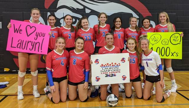 Riverside players pose after a win over Covington on Saturday. Lauryn Sanford reached 1,000 career assists in the win.