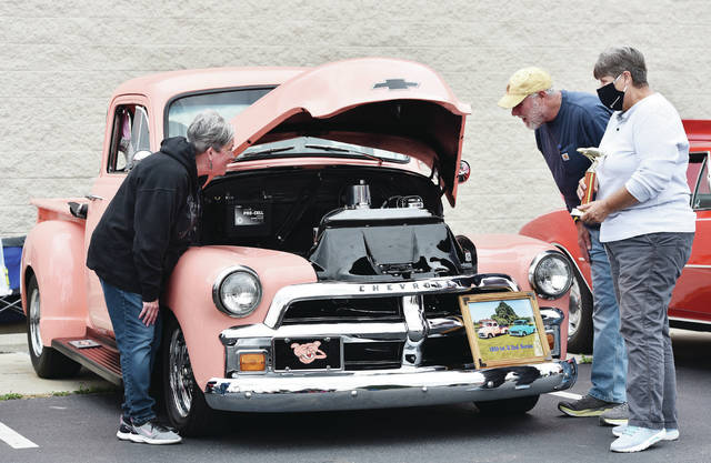 Allison, left to right, and Tim Martin, both of Sidney, look at the best of show 1955 1st series Chevy 3100 co-owned by Jeri Hix, of Brookville, at the Ty Martin Memorial Car Show on Saturday, Oct. 3. The car show was held in the Advance Auto Parts parking lot. Money raised will go to fund the Ty Austin Martin Memorial Mission Scholarship. Martin passed away in 2016 after a while on a mission trip in Mexico. The car's other owner is Carolyn Bolin.