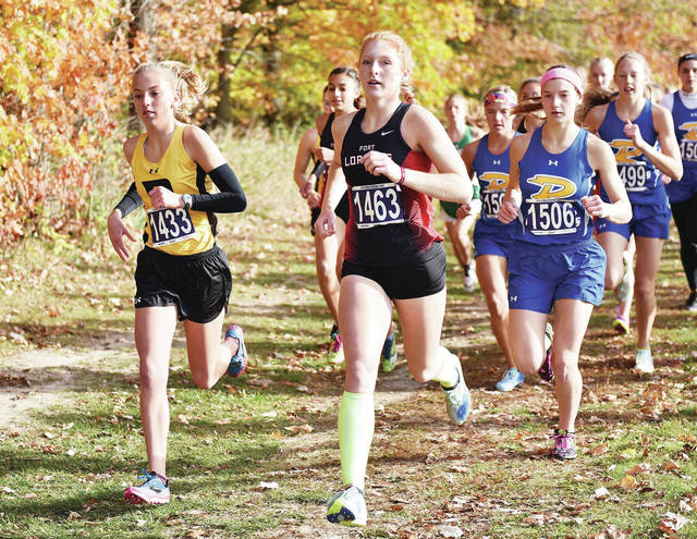 Running at the front of the pack near the beginning of the girls race in the Shelby County Athletic League meet on Saturday at Botkins Community Park are, left to right, Botkins' Brittany Arnold, Fort Loramie's Dani Eilerman and Russia's Becca Seger. Arnold came in first place, Eilerman fourth place and Seger in ninth place.