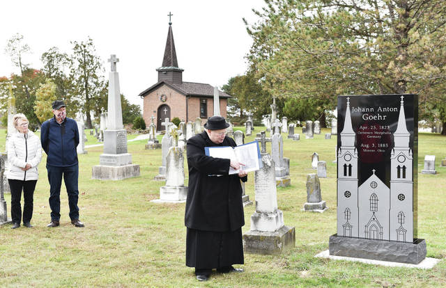 Rev. David Hoying, of Carthagena, talks about church architect and master builder Johann Anton Goehr during a dedication ceremony for a new monument for Goehr at St. Augustine Cemetery, in Minster, on Sunday, Oct. 25. Goehr had a hand in constructing St. Remy in Russia and Holy Angels in Sidney among a number of others.