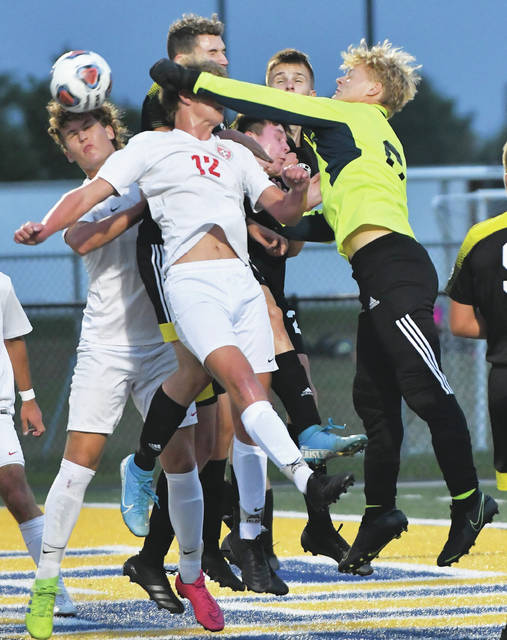 Sidney's Joshua Webster attempts to win possession against a Tippecanoe player during a Miami Valley League game on Sept. 17 at Sidney Memorial Stadium. Boberg has made 95 saves this season for the Yellow Jackets, which are in first place in the MVL Valley Division.
