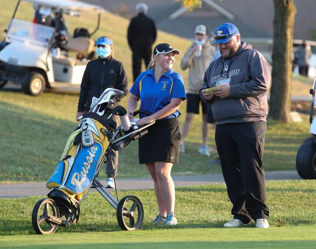 Russia junior Makenna Borchers talks with coach Brock Faulknor during the Division II district tournament on Wednesday at Pipestone Golf Course. Borchers set a school record by shooting an 84.