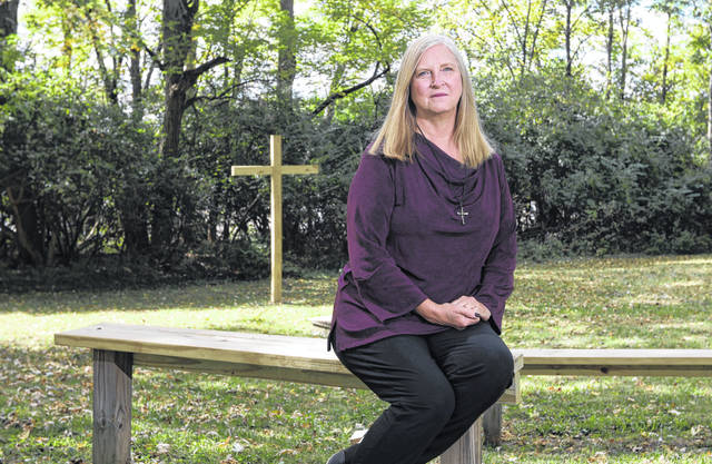 Rev. Deborah Bowsher at Trinity United Presbyterian Church's outdoor gathering place near the church in Zanesville.