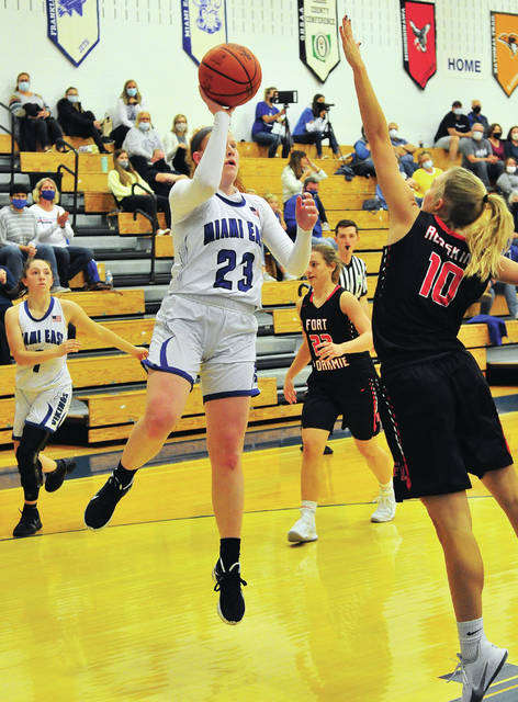 Fort Loramie's Kenzie Hoelscher, left, tries to block a shot by Miami East's Kayly Fetters during a nonconference game on Friday in Casstown. The Redskins opened the season with a 62-21 win.