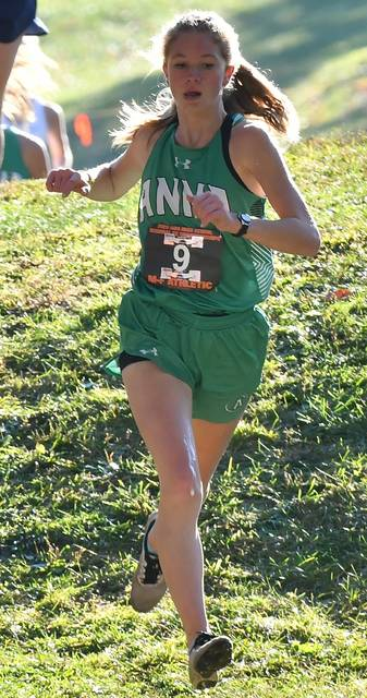 Anna's Grace Bensman runs during the Division III girls race in the regional cross country meet on Saturday in Troy. The Rockets finished third to earn a state berth and will compete on Saturday with the school's boys squad, which also finished third.