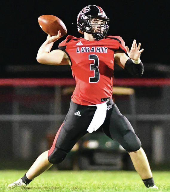 Fort Loramie senior quarterback Collin Moore throws during the first half of a Cross County Conference game on Thursday at Smith Field in Covington. Moore, who threw for 1,564 yards in nine games, was named first team all-CCC.