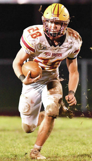New Bremen's Zach Bertke runs during the second half of a Division VII, Region 28 semifinal on Oct. 30 at Redskin Stadium in Fort Loramie. The Cardinals will face Warren JFK in the Div. VII state final on Friday at Massillon's Paul Brown Tiger Stadium.