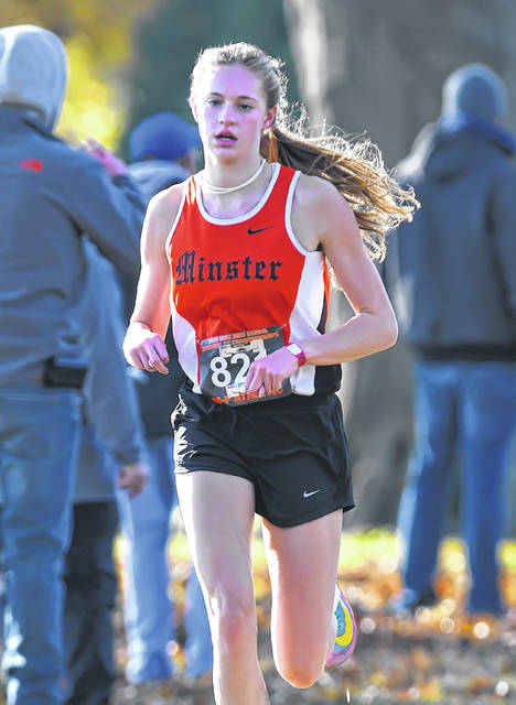 Minster's Ella Boate runs during the Division III boys race in the regional cross country meet on Saturday at Hedges Boyer Park in Tiffin.